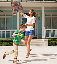 Mom and kid playing with kite