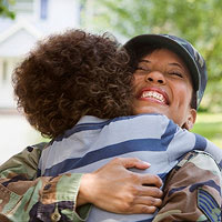 returning soldier hugging her son