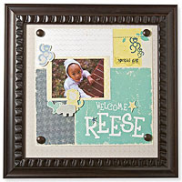 Black picture frame with baby photo an ?Welcome Reese?