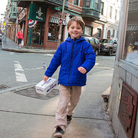 boy walking around in city