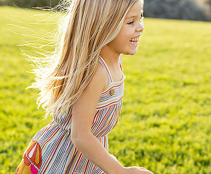 girl running outside in the grass