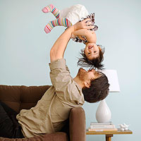 Dad holding baby in air