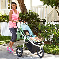 Mom pushing baby in stroller