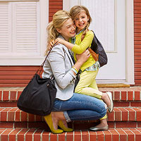 mother hugging child who is leaving for school