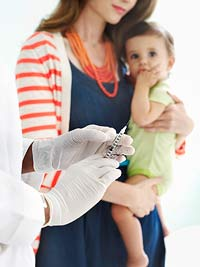 Mom holding baby before a vaccine