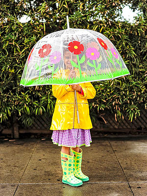 Girl standing under flower umbrella