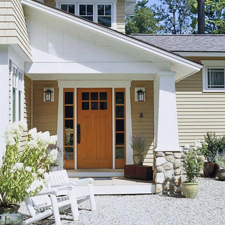 entryway with a red door with white trim