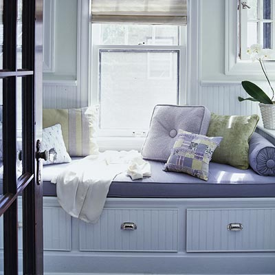 window seat with drawers and lavender cushions