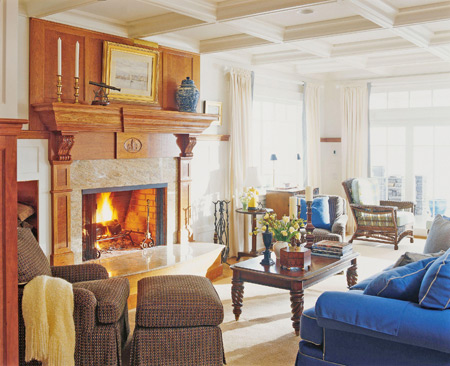 A pretty living room with a fireplace and drop ceiling