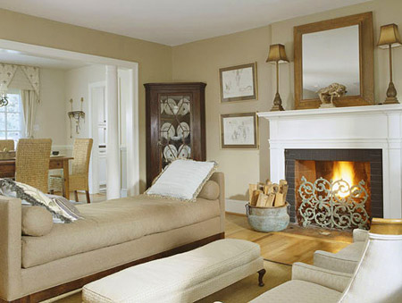 A new white mantel brightens the cottage fireplace, a cozy distance from a backless chaise