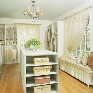 Walk-in closet with center island for storage
