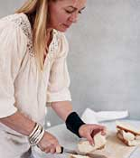 woman cutting sandwiches
