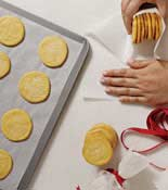 Baked cookies being wrapped in shear paper
