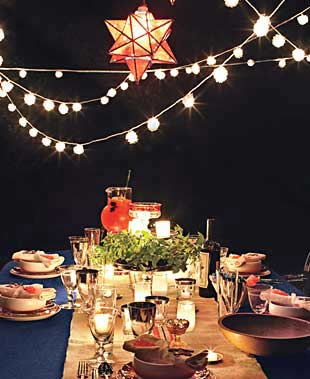 table setting with twinkle lights