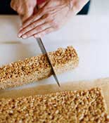Rice Crispy Treat being cut into pieces