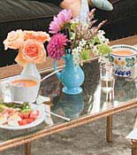 Table with Flowers and food on it