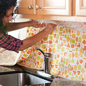 Lady Putting Decorative Backsplash up