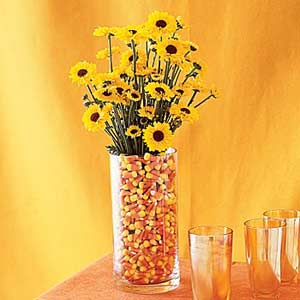 candy corn vase with daisies