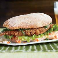 Schnitzel-wich with Garlic Butter and Hot Relish