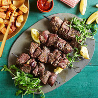 Garlicky Beef Skewers with Potato Hash & Spiked Ketchup