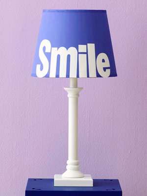 Computer-printed adhesive-backed paper letters attached to lampshade;