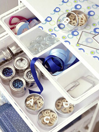 Sort scrapbooking supplies into a mobile cart