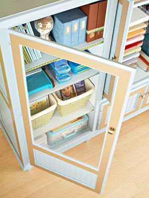 DISPLAY PROJECTS BEHIND AN ARMOIRE?S CLEAR DOORS