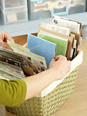 USE DECORATIVE BASKETS AS STICKER STORAGE