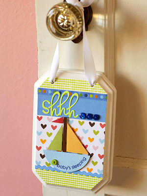 HANG A SCRAPBOOKING SUPPLY DECORATED DOOR SIGN