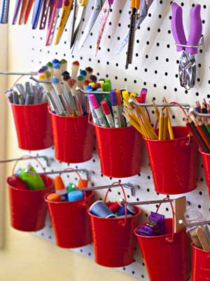Colorful buckets holding loose supplies