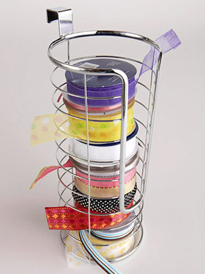 USE A TOILET-PAPER HOLDER TO CONTAIN SPOOLS OF RIBBON
