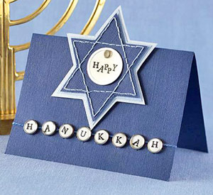 Create An Eye-Catching Hanukkah Card Using Stamped Letters, Tags, And Conchos