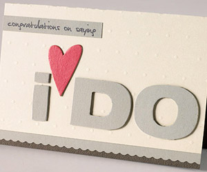 USE CHIPBOARD LETTERS TO SPELL OUT A WEDDING SENTIMENT