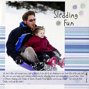 SNOWCASE A SINGLE LARGE SLEDDING PHOTO ON A SIMPLE SCRAPBOOK PAGE