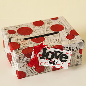 Recycled newspaper glitter valentine box