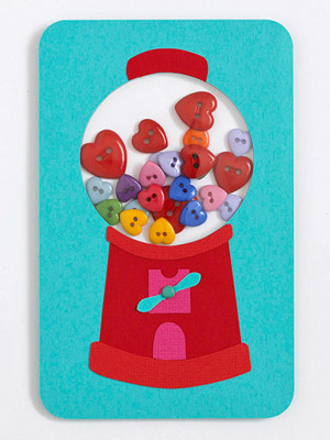 Paper gum ball machine filled with button hearts