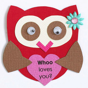 Owl holding a heart