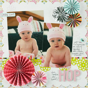 Baby scrapbook page with rosette flower accents made from paper