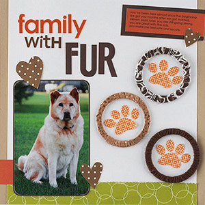 Scrapbook page about a dog, pet; ribbon scraps wrapped around circles