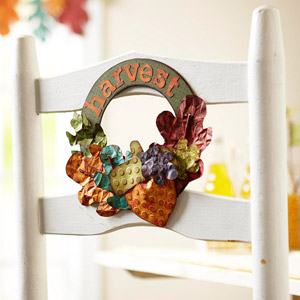 Harvest paper wreath on back of white chair