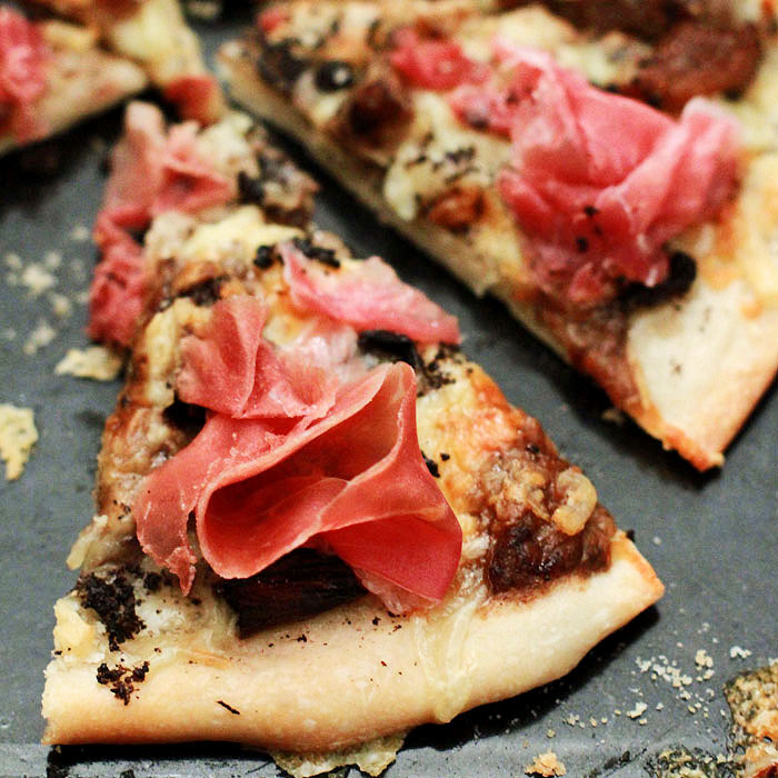 Grilled Caramelized-Onion Pizza with Rosemary, Olives, and Prosciutto