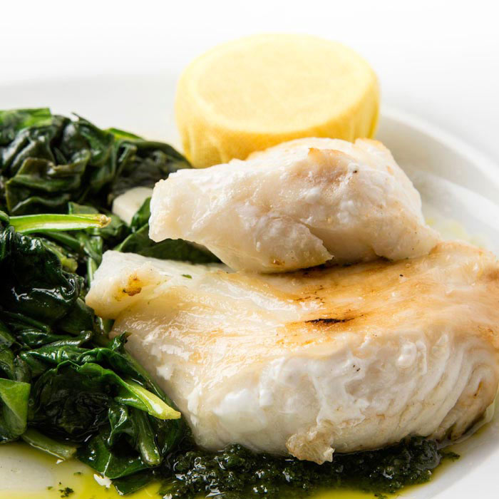 Pan-Seared Cod With Garlic Greens and Parmesan Polenta Toasts