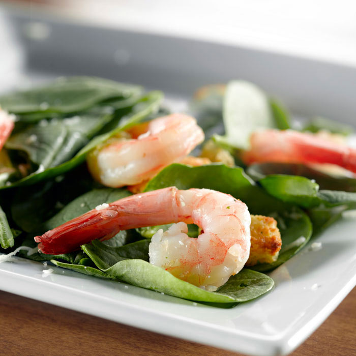 Warm Spinach Salad with Grilled Shrimp, Almonds, and Dried Cranberries