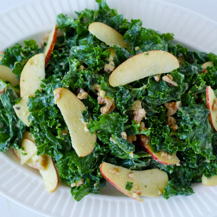 Raw Kale Salad with Apple and Creamy Avocado Dressing
