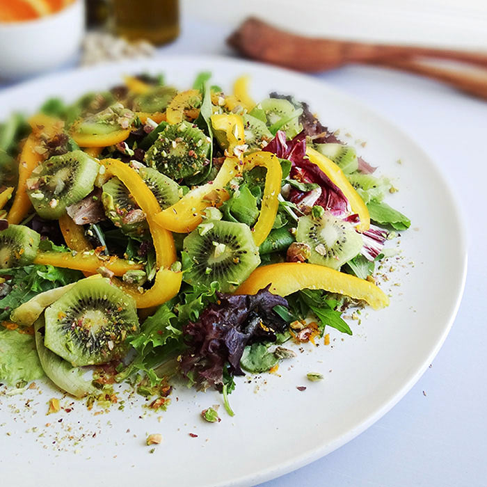 Kiwi Herb Salad with Pistachios and Orange Dressing