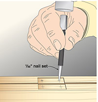Using a nail set to mark drilling holes