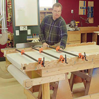 Man putting clamps on table