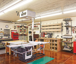 Interior view of shop, white tablesaws, brown floor