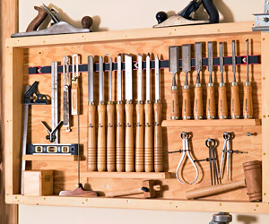 Rack on wall with tools