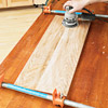 Board w/blue clamps and sander